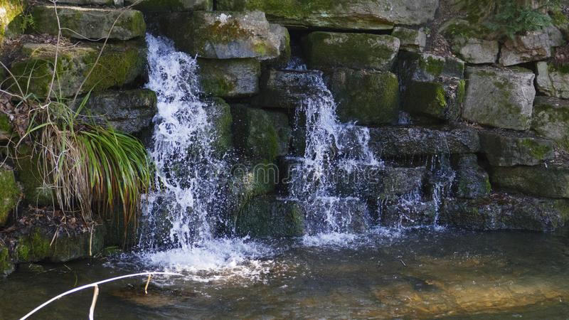 Small waterfall, in the lake in Foerch, in the public park castle Favorite stock photography