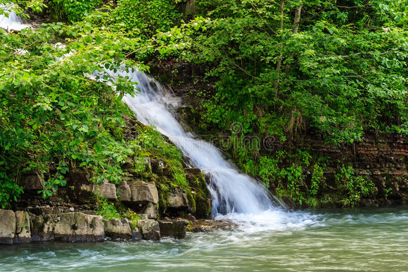 Small waterfall on a little mountain stream royalty free stock image