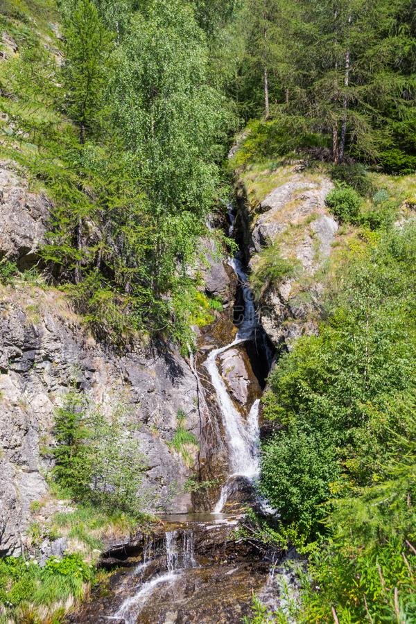 A small waterfall in the mountain stock image