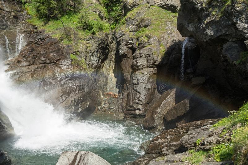 Small waterfall with the rainbow stock photos