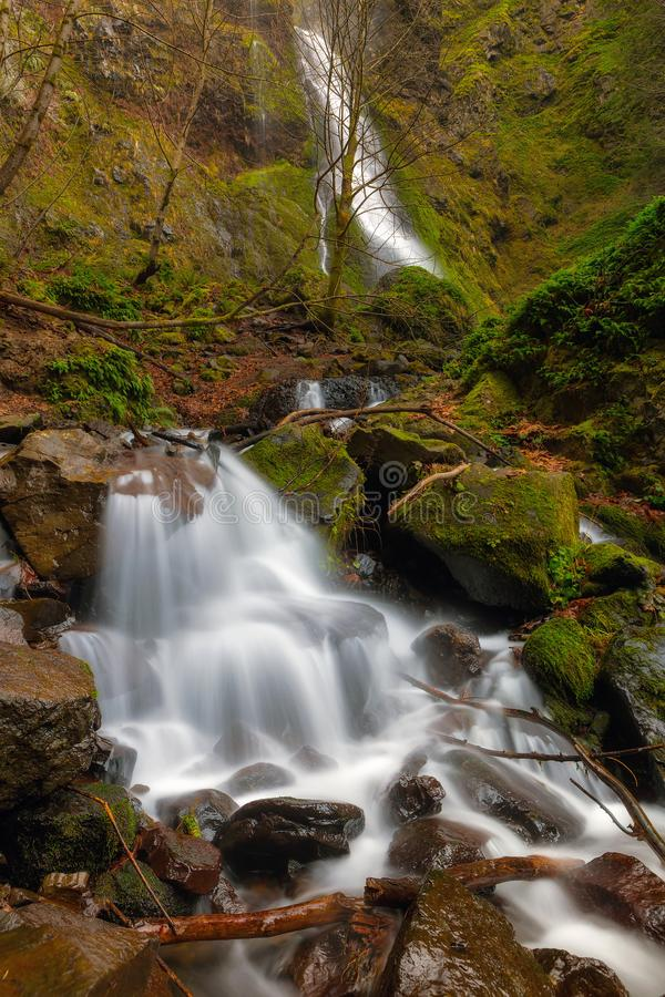 Small Waterfall by Starvation Creek Falls in Oregon. Waterfall at Starvation Creek State Park in winter season in Portland Oregon USA stock image