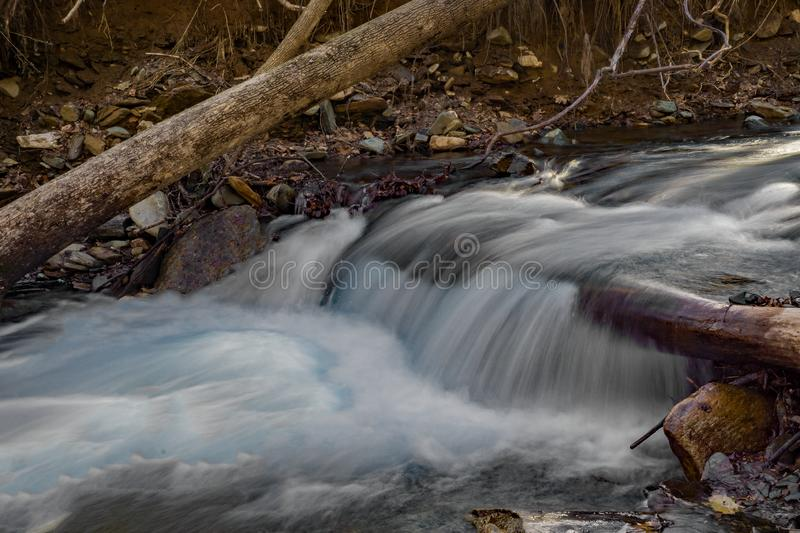 Waterfall on a Wild Mountain Trout Stream. Small waterfall on a wild mountain trout stream located next to the Rock Castle Gorge Trail located in the Blue Ridge stock photo