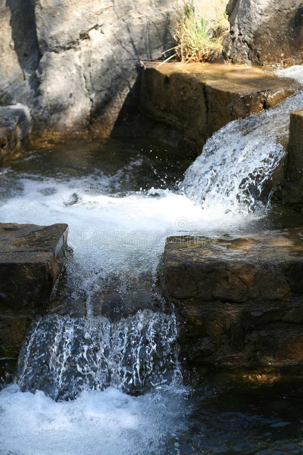 Small waterfalls in the mountains royalty free stock photography