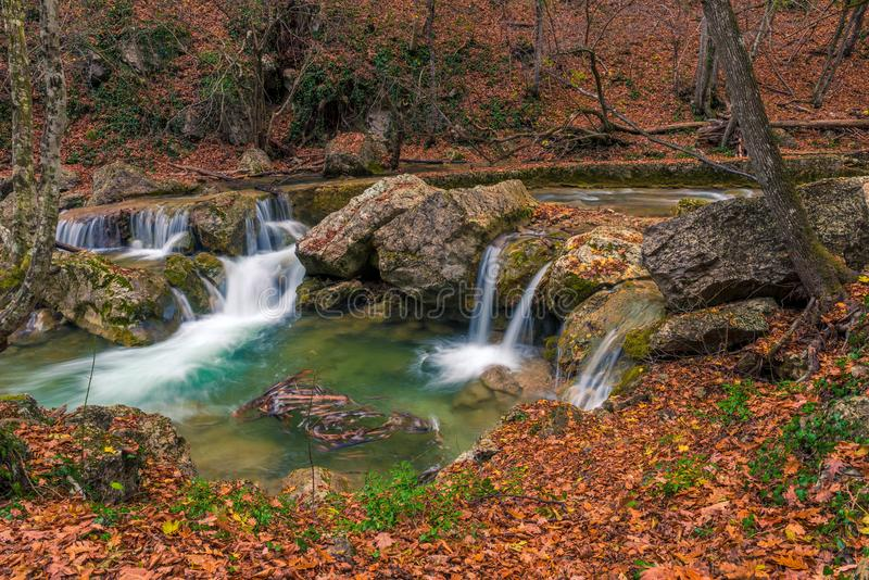 small waterfalls and a river postcard view in a beautiful natural location in the autumn mountain royalty free stock photography