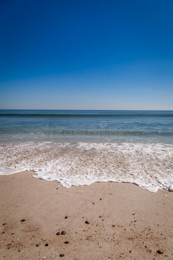Gentle waves wash ashore on Amelia Island royalty free stock image