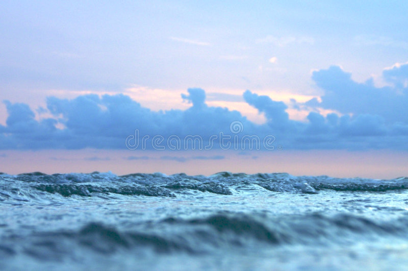 Download Small waves and stormy sky stock photo. Image of beach - 1717800