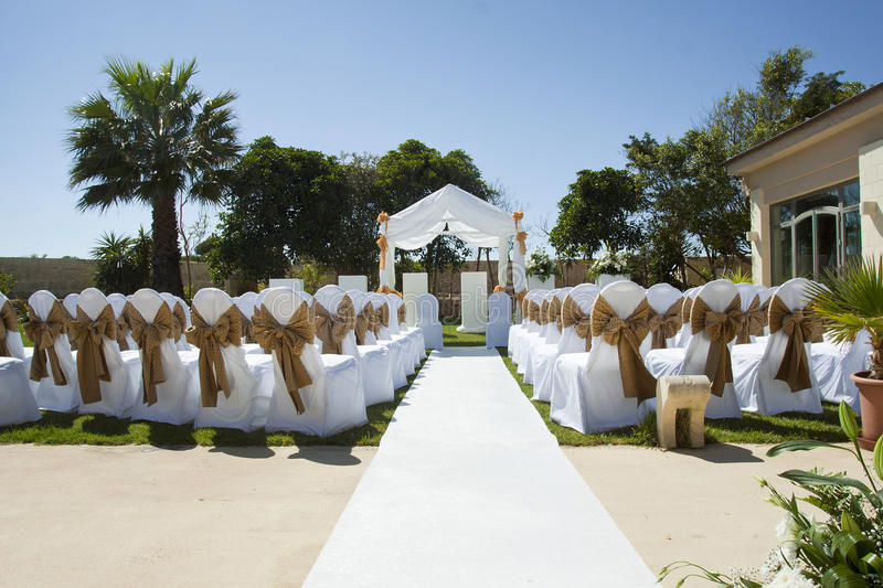 Small wedding tent in garden with chairs on lawn royalty free stock photos