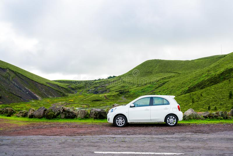 Beautiful Small white car standing by the road side. Small white car standing by the road side on the Sao Miguel island, Azores stock photography