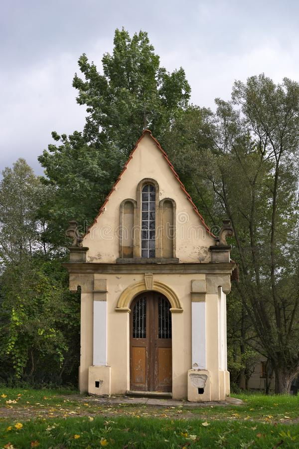 Small white chapel in the woods in Poland stock photos