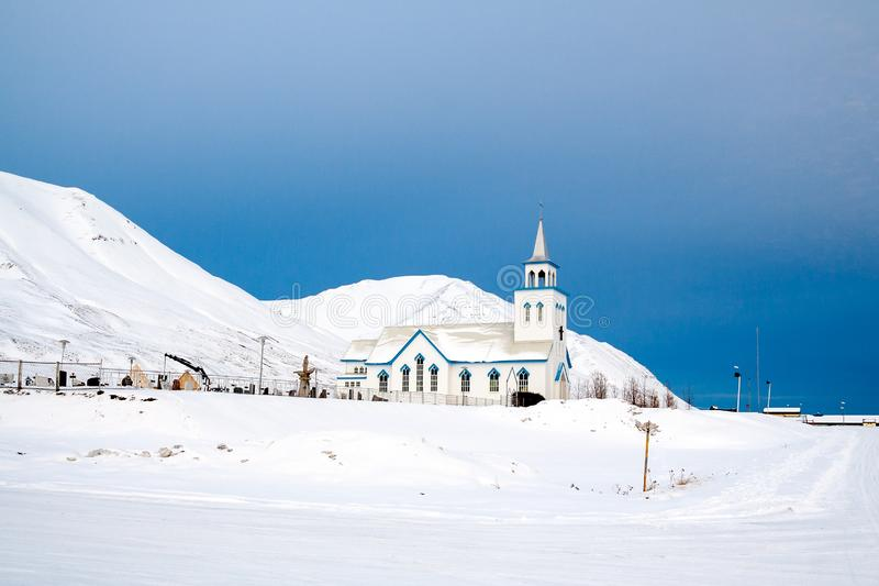 White church surrounded by snow in iceland during winter royalty free stock photos
