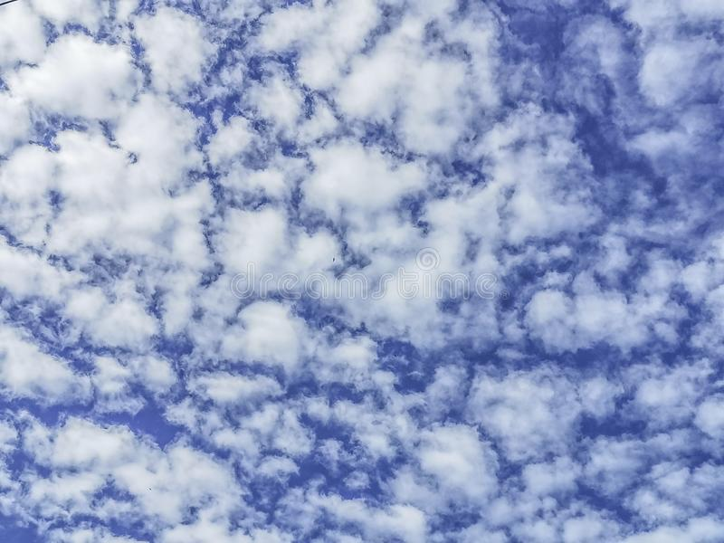 Small white clouds Scattered throughout the blue sky, White cloud in the blue sky, . Beautiful nature background royalty free stock photos