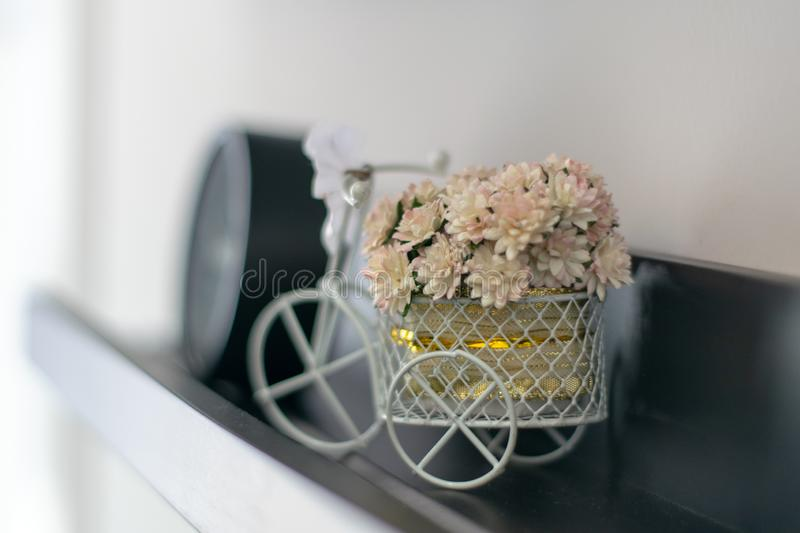 Small white flowers placed on a small basket royalty free stock photography
