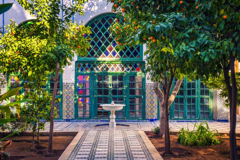 Small white fontaine among orange trees of Jardin Majorelle, Marrakech, Morocco stock images