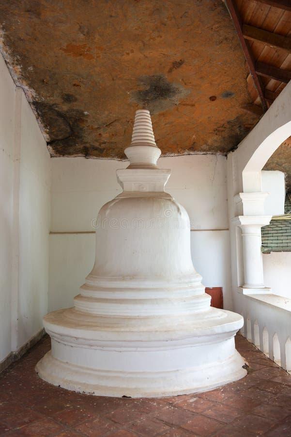 Small white pagoda in buddhist temple. Small white dagoda in Dambulla Golden Cave buddhist temple in Sri Lanka island royalty free stock photos