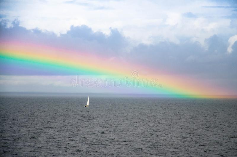 Small white sailing yacht and rainbow in Gulf of Finland, Baltic stock photos