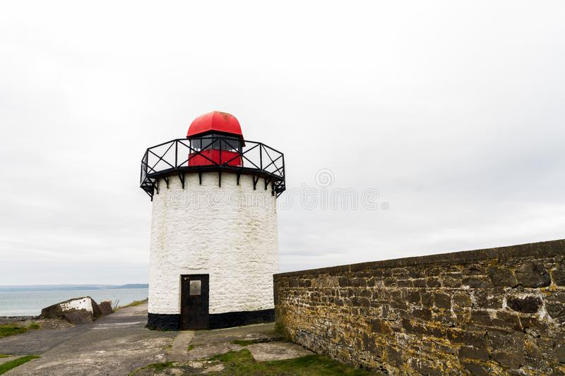 Burry port lighthouse. Small white squat white lighthouse with red top. Burry Port, Llanelli, Carmarthenshire, Wales royalty free stock photos