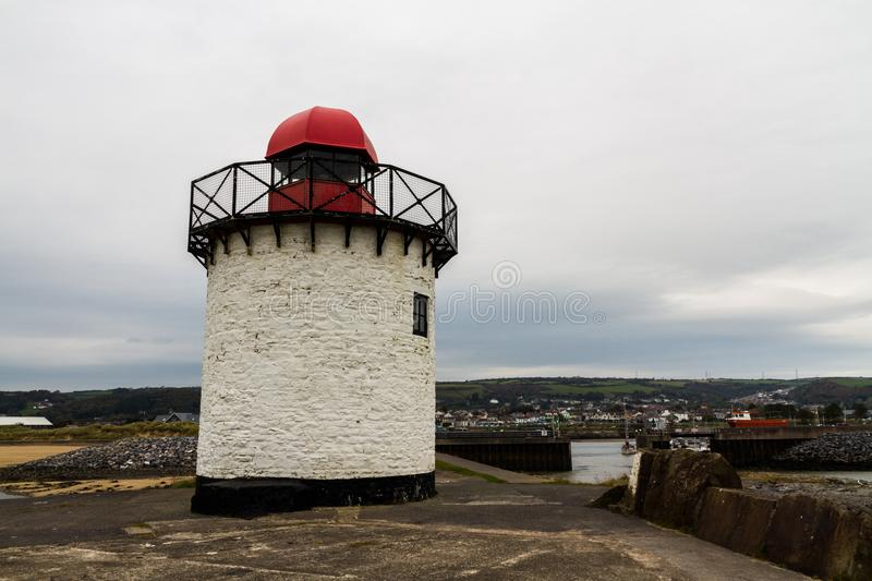 Burry port lighthouse. Small white squat white lighthouse with red top. Burry Port, Llanelli, Carmarthenshire, Wales stock photos