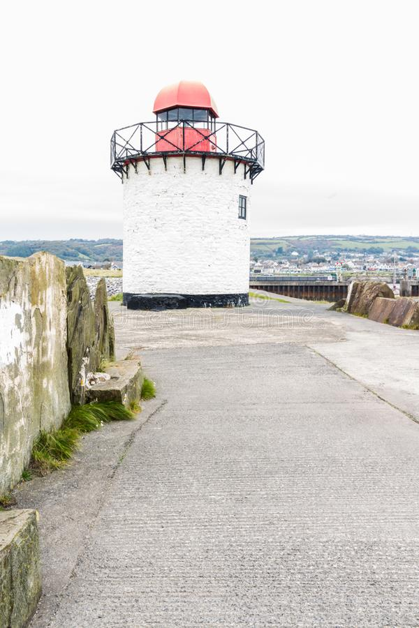 Burry port lighthouse. Small white squat white lighthouse with red top. Burry Port, Llanelli, Carmarthenshire, Wales stock image