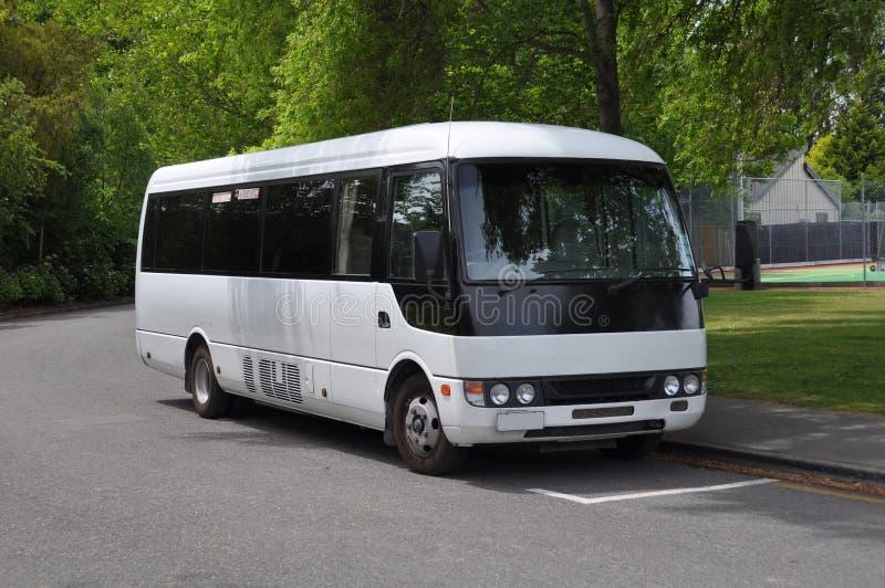 Small White Tour Coach Bus, New Zealand stock photo