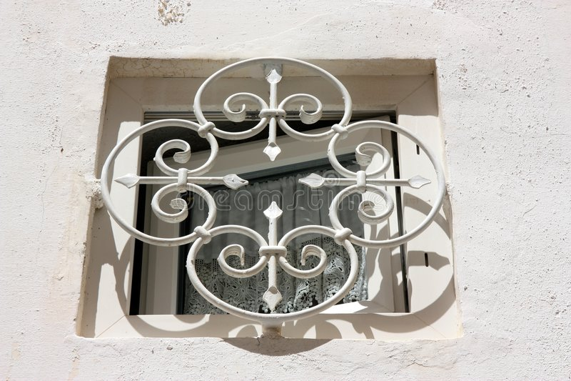 Small white window in Apulia, Italy stock images