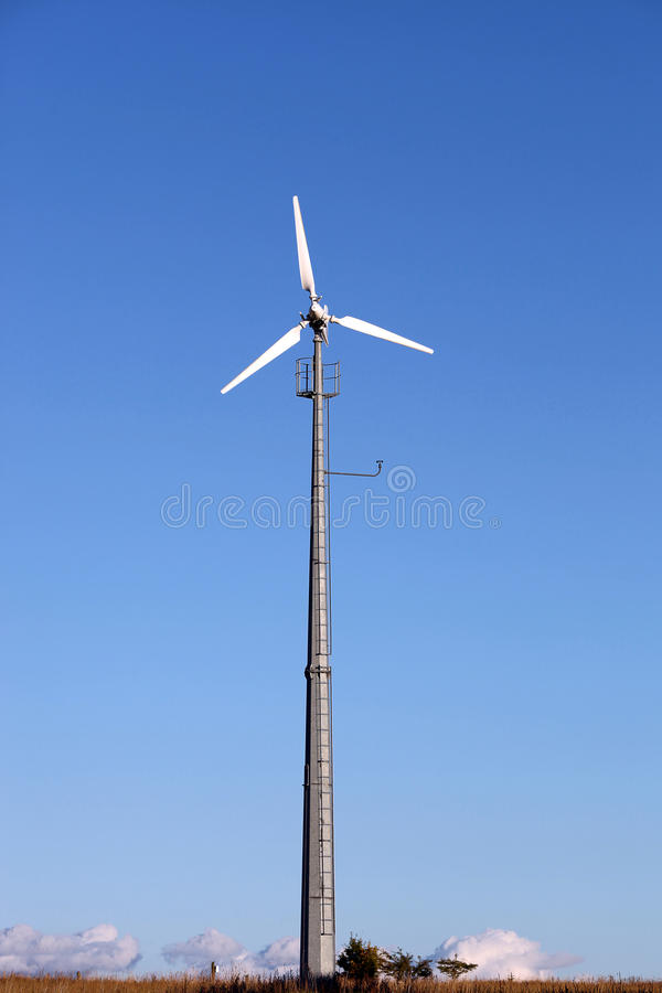 Small wind turbine generating electricity for the household royalty free stock image