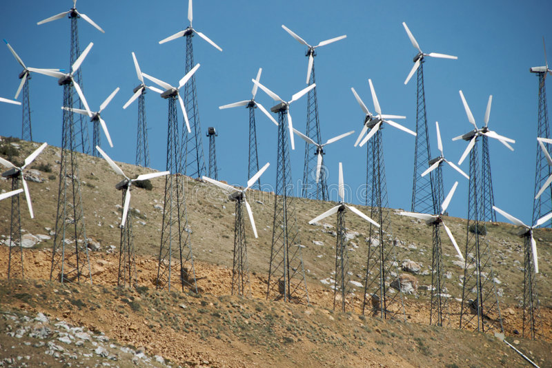 Download Small Wind Turbines On Hillside Royalty Free Stock Images - Image: 9251199