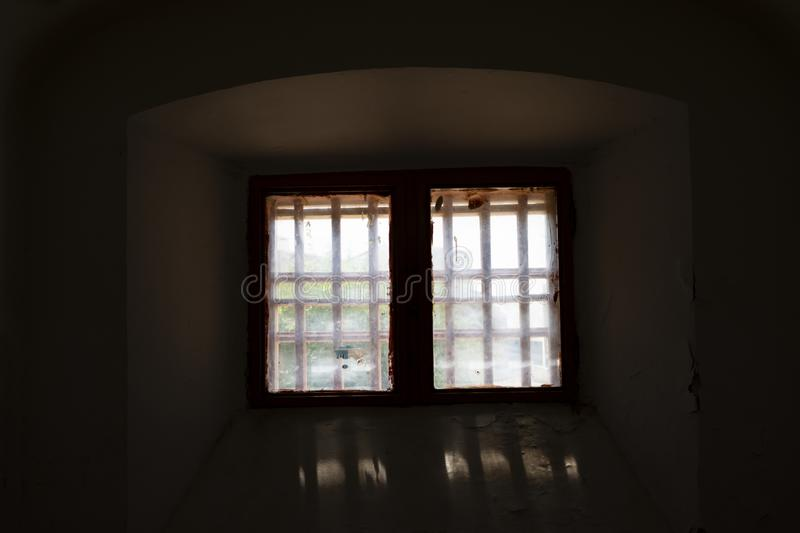 Window in the prison cell royalty free stock photo