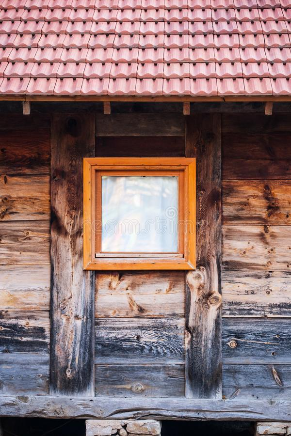 Small window of an old wooden house stock photos