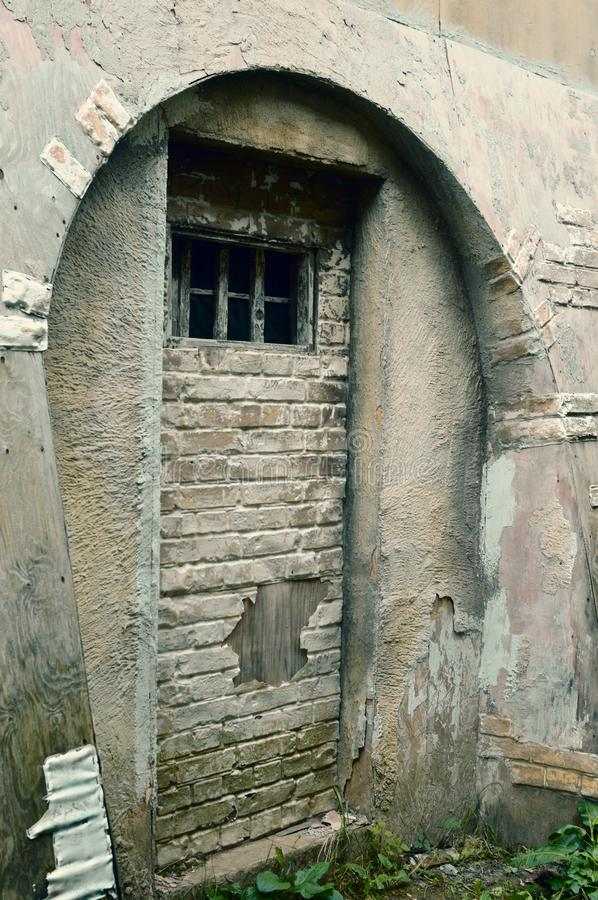 Small window in the prison cell royalty free stock images