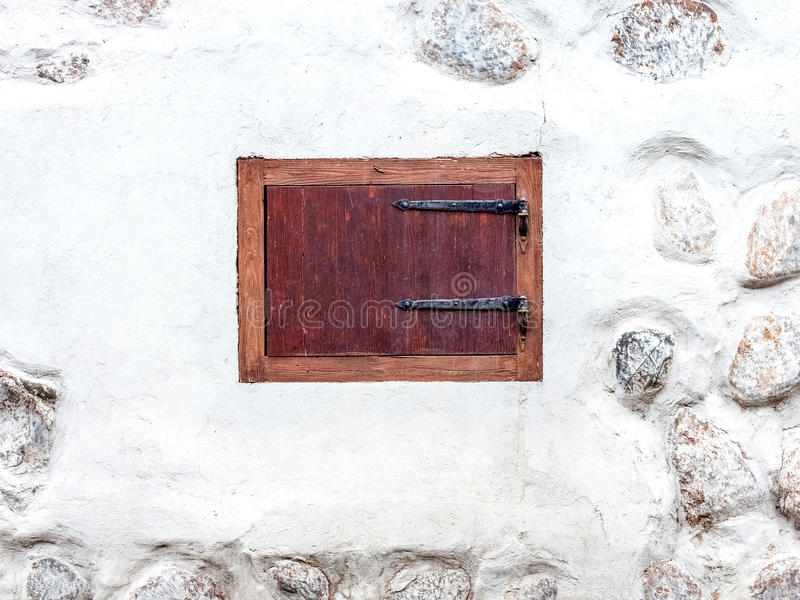 Small window with shutters closed royalty free stock photography