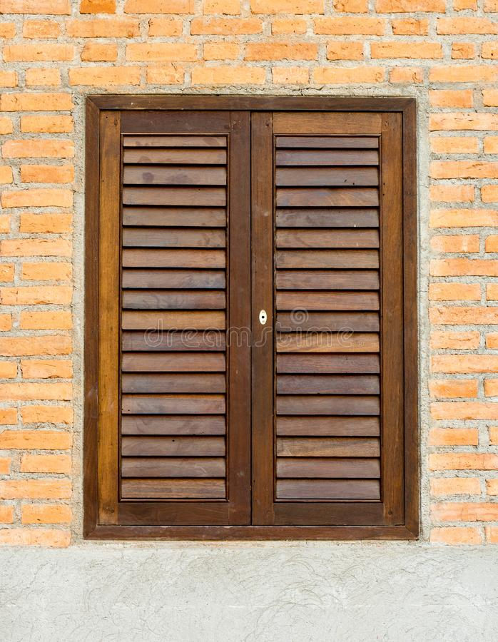 Small window and door on brick wall stock photography