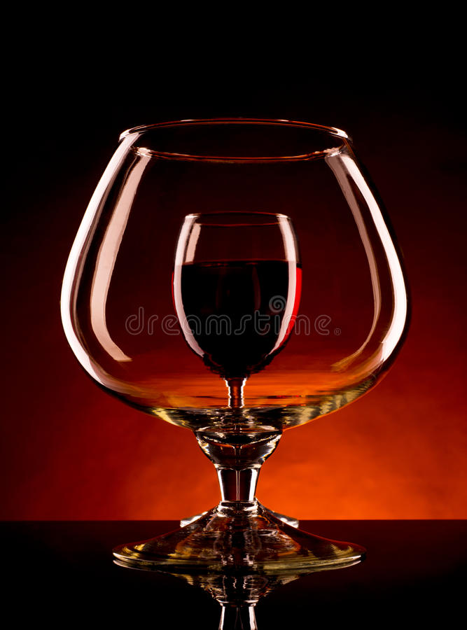 Free Small Wineglass Is Visible Through A Large Glass Of Wine Royalty Free Stock Image - 36367716