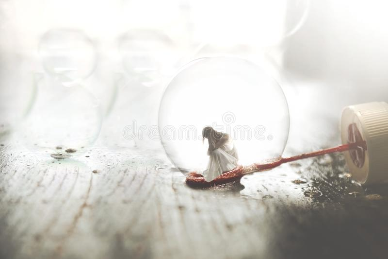Small woman inside a soap bubble, concept of imagination and introspection royalty free stock image