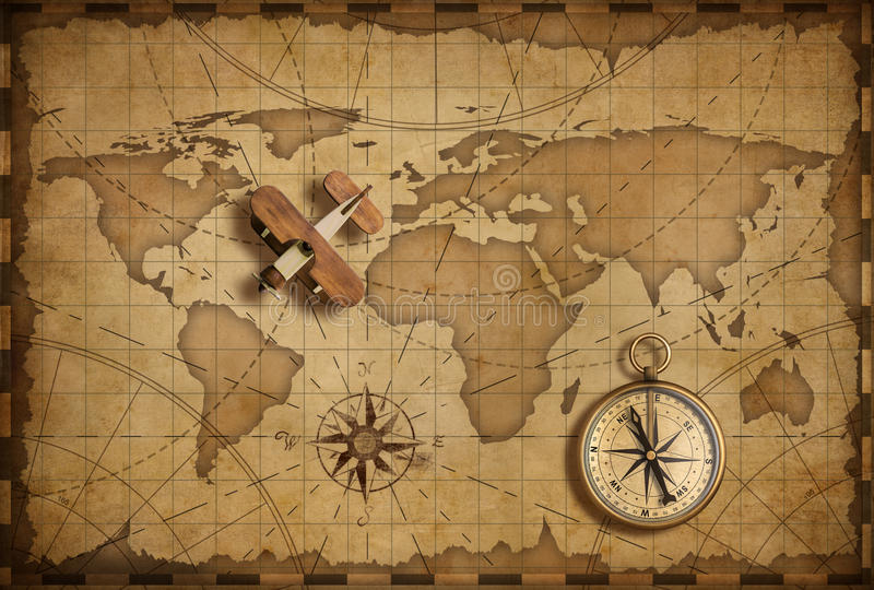 Small wood airplane over world nautical map as travel and communication concept royalty free stock photos