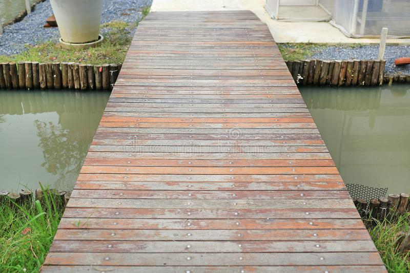 Small wood bridge crossing canal.  royalty free stock photography