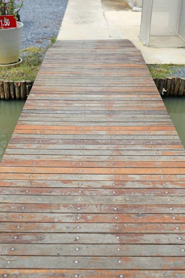 Small wood bridge crossing canal.  stock photos