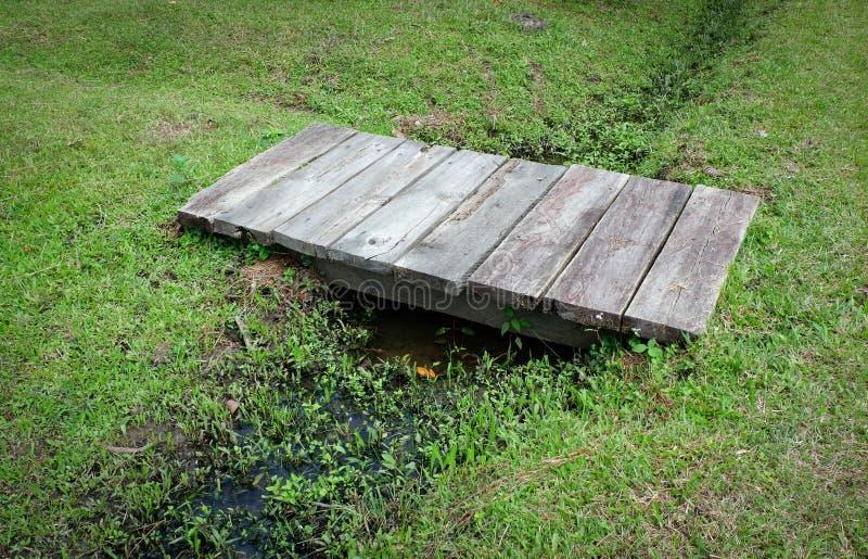 Small wood bridge. Grass floor royalty free stock images