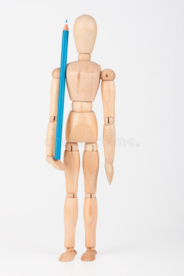 Small wood mannequin standing with colour pencil isolated on white stock photos