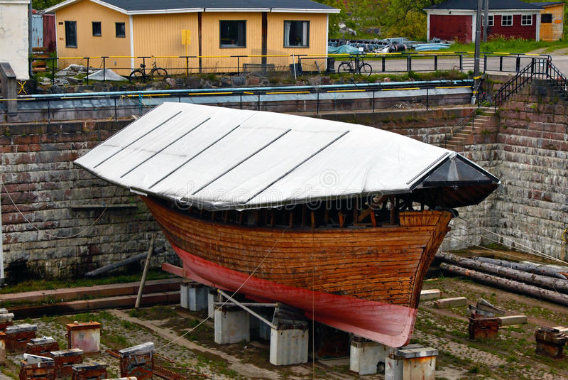 Small wood old boat in Shipyard stock photo