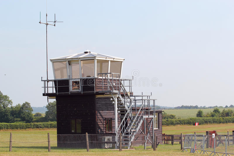 Small wooden airport control tower. A small wooden control tower on a private airfield in the United Kingdom stock images