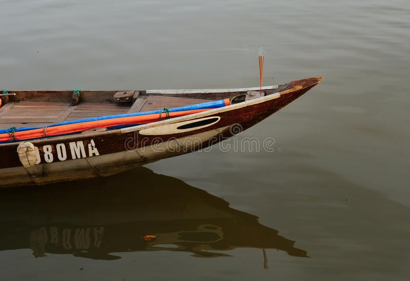 A small wooden boat on the river royalty free stock photos