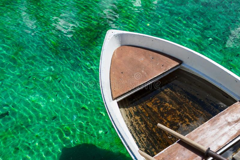 Small wooden boat in turquoise water Two ducks swimming in Lago Ghedina, an alpine lake in Cortina D`Ampezzo, Dolomites, Italy stock photography