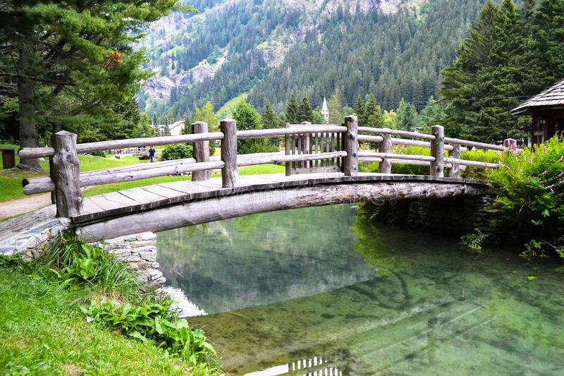 Small wooden bridge over the lake royalty free stock photography