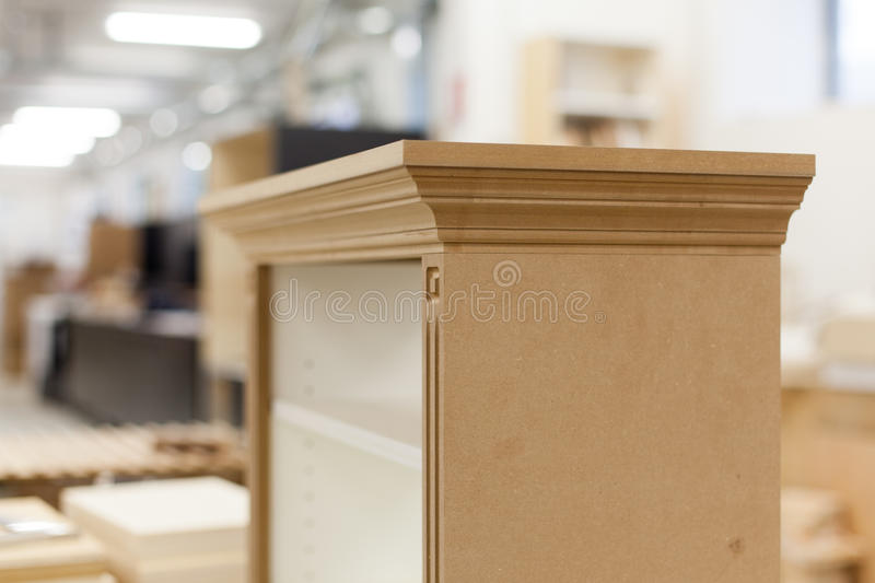 Small wooden cabinet assembly stock image