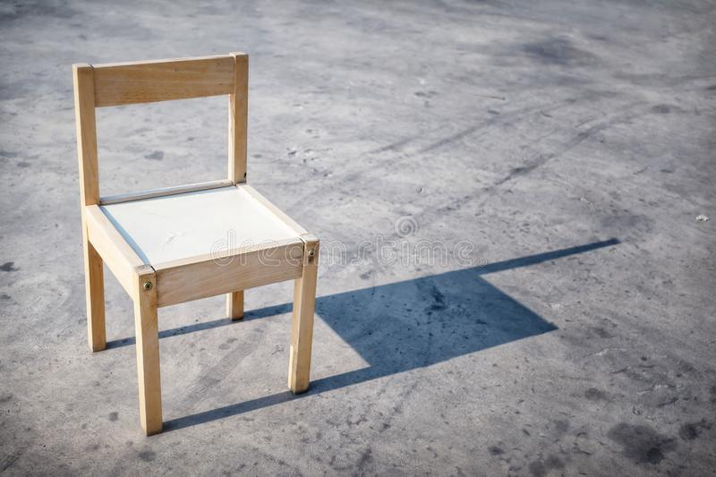 Small Wooden Chair in the Sunlight.  stock images