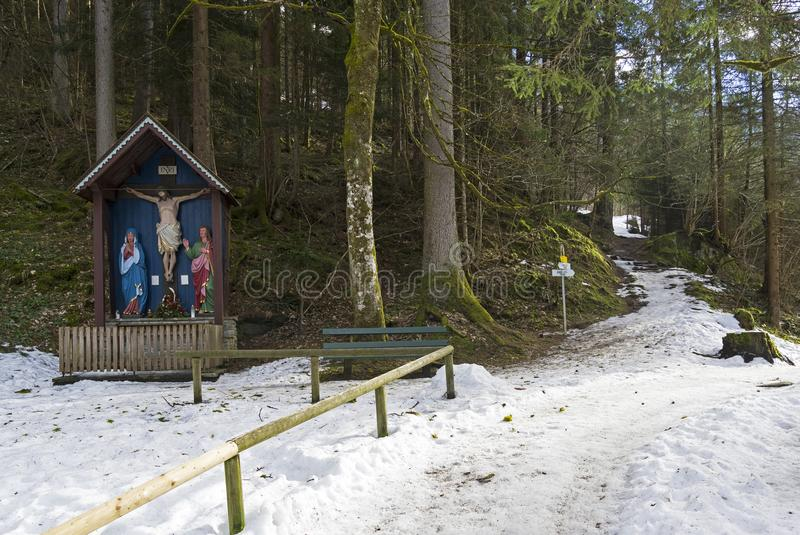 A small wooden chapel with a crucifix near the mountain path. Surroundings of the ski resort of Mayrhofen, Tyrol, Austria. Early March stock images
