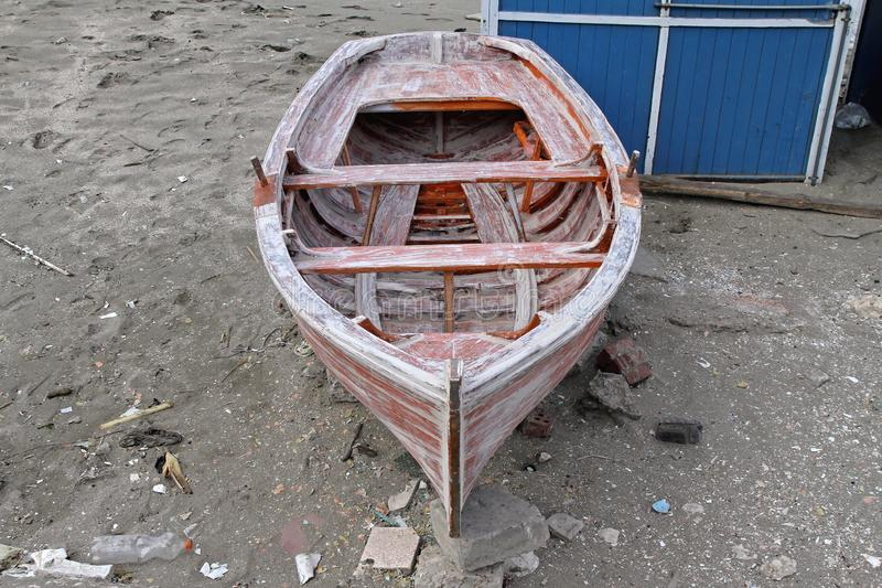 Dinghy Boat. Small Wooden Dinghy Boat Repair at Beach royalty free stock images