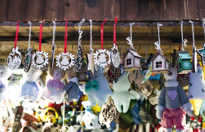 Small wooden handmade toys at Christmas market stock photos