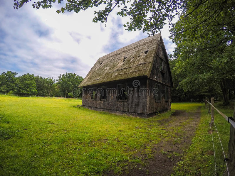 Small wooden horse barn royalty free stock images