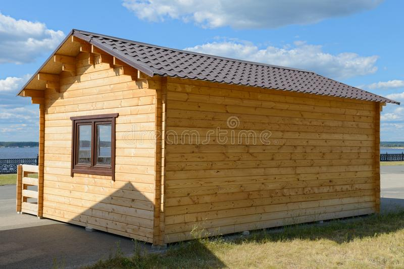 Small wooden house in the street royalty free stock image